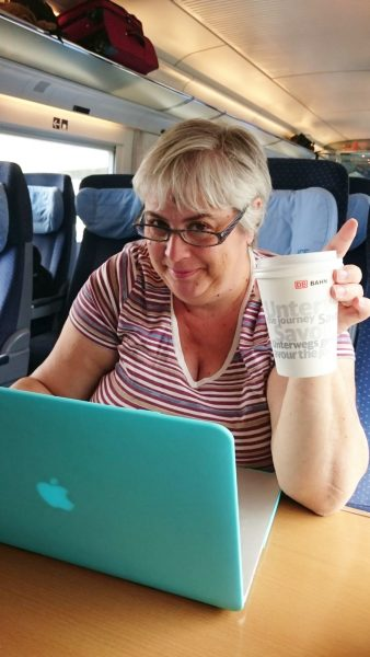 Corinne Typing on Computer on Train.